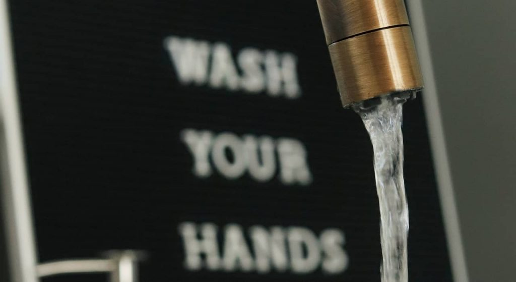Wash your hands with soap and running water for at least twenty seconds to prevent Corona virus (COVID-19) infection